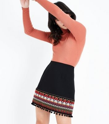 black-pom-pom-hem-mini-skirt.jpg